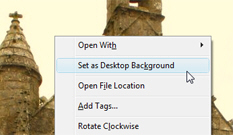 Change the desktop wallpaper through Windows Photo Gallery