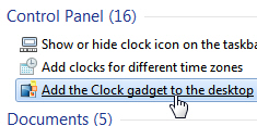 Get the clock gadget and add it to your Windows 7 desktop