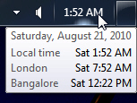 Windows 7 displaying three different clocks in the tray